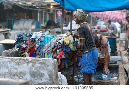 Indian Workers Washing Clothes At Dhobi Ghat In Mumbai, Maharashtra, India