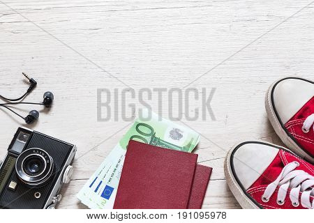 Set of travel stuff on old wooden background