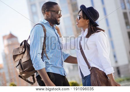 Never bored together. Two ambitious energetic fun people having an active day and walking around the city together while seeming satisfied