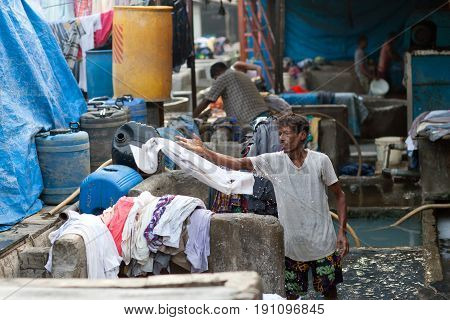 Workers Washing Clothes At Dhobi Ghat In Mumbai, Maharashtra, India