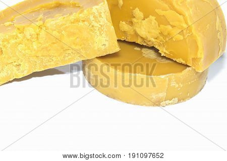 beeswax on a white background. An environmentally friendly product. Natural.