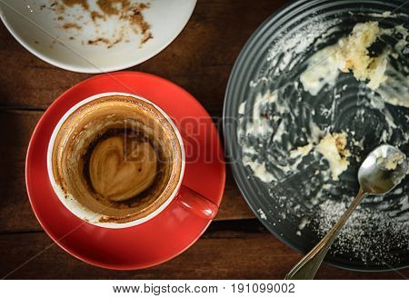 coffee depleted on table wood in cafe shop