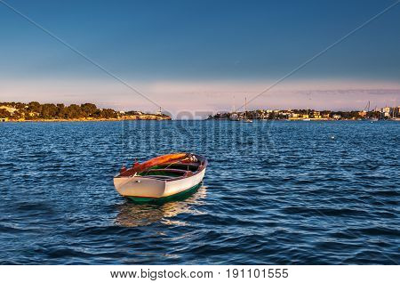 Lonely boat sailing free in the blue sea