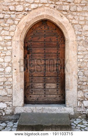 Ancient wooden arched door.