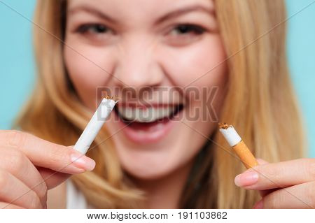 Smilling Girl Is Breaking Cigarette