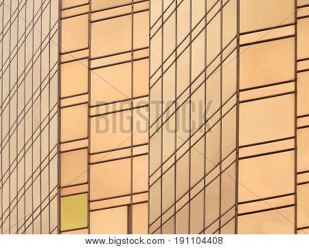 Reflective gold glass facade on modern building