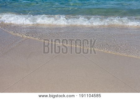 The photo of small waves lapped the beach
