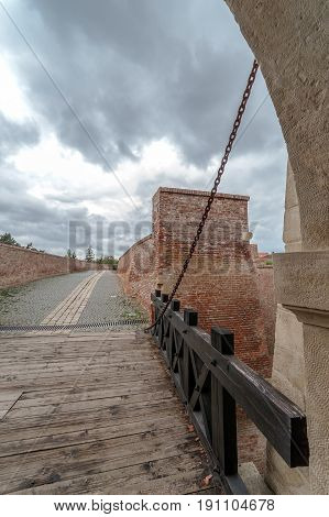 View at one gate for enterance in medieval fortress of Alba Iulia (Carolina)Transylvania Romania. Bridge in front.