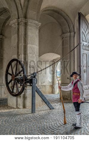 ALBA IULIA ROMANIA - APRIL 29 2017: View at principal gate for entrance in medieval fortress of Alba Iulia (Carolina)Transylvania Romania with soldier in front.