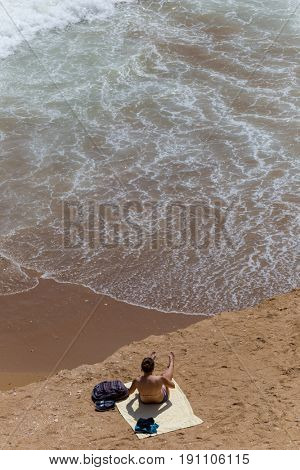 LAGOS, PORTUGAL - APRIL 23, 2017: People at the beach of Praia Dona Ana in Lagos, Algarve region, Portugal