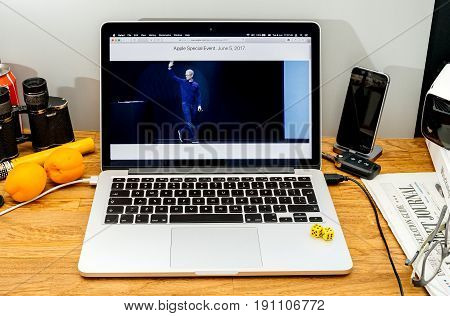 PARIS FRANCE - JUNE 6 2017: Apple Computers website on MacBook Retina in creative environment showcasing Tim Cook welcomes developers from 75 different countries WWDC 2017