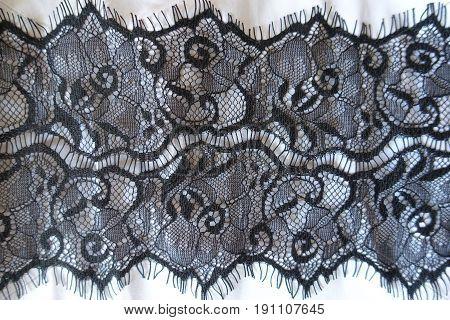 Black Guipure Lace Over White Cotton Fabric