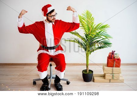 A portrait of a handsome model dressed as santa