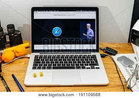 PARIS FRANCE - JUNE 6 2017: Apple Computers website on MacBook laptop in creative environment showcasing Apple Craig Federighi previews macOS High Sierra at WWDC 2017 - talking about improvements in Safari web browser