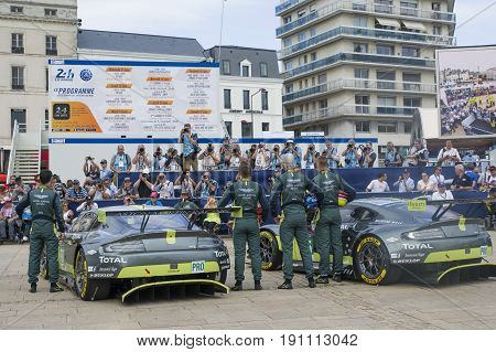 LE MANS FRANCE - JUNE 11 2017: Famous Danish racer Nicki Thiim with his race car Aston Martin and team Weighing administrative and technical checks of the race cars for competition 24 hours of Le mans circuit
