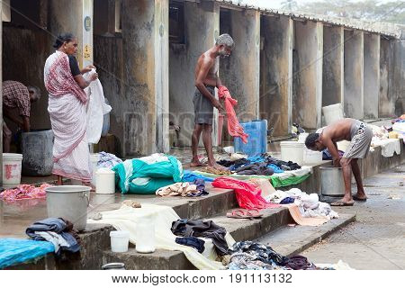 COCHIN, INDIA - JANUARY 21, 2016: Indian people working hard on Dhobi Ghat in Fort Cochin, Kerala, South India