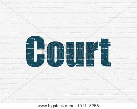 Law concept: Painted blue text Court on White Brick wall background