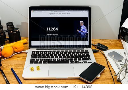 PARIS FRANCE - JUNE 6 2017: Apple Computers website on MacBook laptop in creative environment showcasing Apple Craig Federighi previews macOS High Sierra at WWDC 2017 - Old H264 advanced video coding old standard
