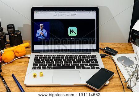 PARIS FRANCE - JUNE 6 2017: Apple Computers website on MacBook laptop in creative environment showcasing Apple Craig Federighi previews macOS High Sierra at WWDC 2017 - Apple Metal improvements hardware