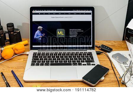 PARIS FRANCE - JUNE 6 2017: Apple Computers website on MacBook laptop in creative environment showcasing Apple Craig Federighi previews macOS High Sierra at WWDC 2017 - Metal performance on Apple