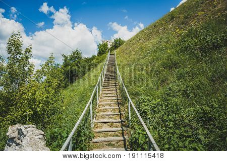 Man-made staircase upstairs to the hill with green grass, travel and tourism concept, Divnogorie, Voronezh region