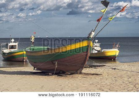 Three fisherman boats at sunny day on the beach