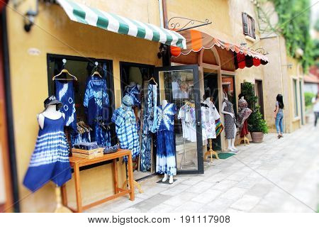 Body mannequins wearing clothes for sale in market