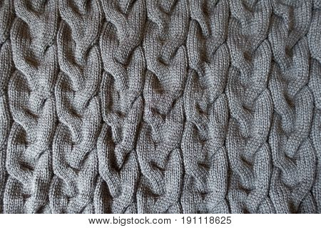 Plait Pattern On Grey Knit Fabric From Above