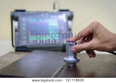 Inspector use ultrasonic testing machine for inspection defect in steel structure.