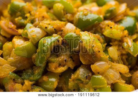 shimla mirch sabji or simla mirch sabzi or spicy capsicum indian food or vegetable recipe using lot of onion and chikpea flour