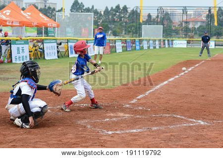 ZHONGSHAN, GUANGDONG,China - October 28:unknown batter about to hit the ball in a baseball game on October 28, 2016.