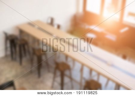 table and chair in food court cafe coffee shop cafeteria restaurant interior blur defocused background