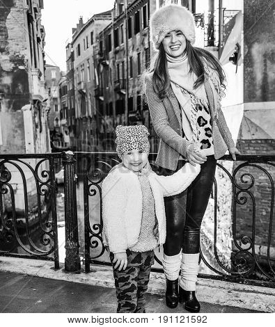 Mother And Daughter Tourists In Venice Having Walking Tour