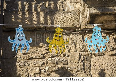 Photo of three decorations with several colours and sunlight