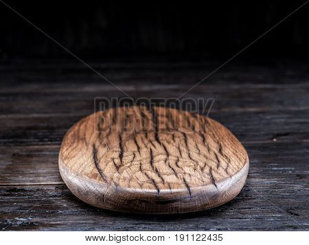 Empty chopping wooden board on the wooden table.