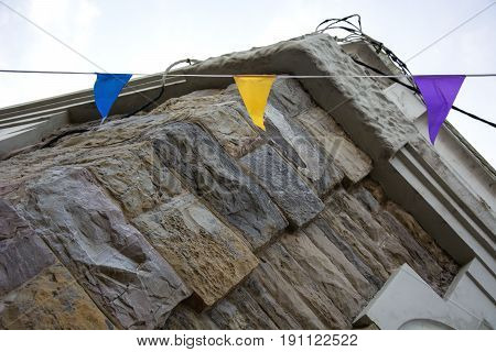 Photo of several decorations with stone wall and sunlight