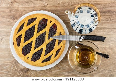 Bilberry Pie In White Dish, Teapot, Knife And Tea