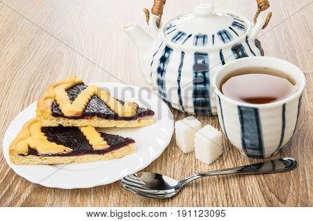 Pieces Of Bilberry, Teapot, Cup Of Tea, Lumpy Sugar