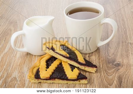 Two Pieces Of Bilberry Pie, Jug Of Milk And Tea