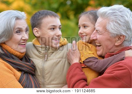 Family portrait of grandparents and grandchildren outdoors