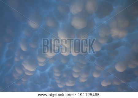 Mammatus clouds fill the sky after a passing supercell thunderstorm.