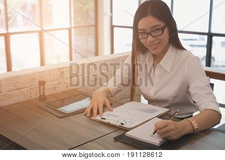 Businesswoman Analyze Market Chart At Workplace. Young Female Entrepreneur Woman Working With Busine