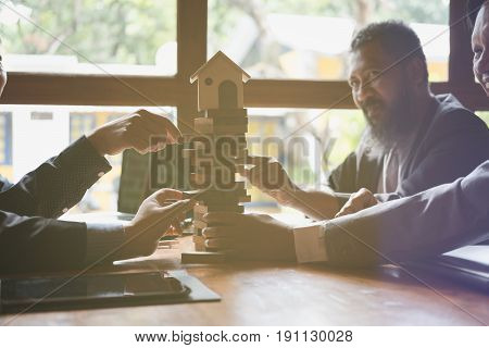 Architect, House Developer And Businessman Pulling Out Wood Building Block From Tower. Business Stra