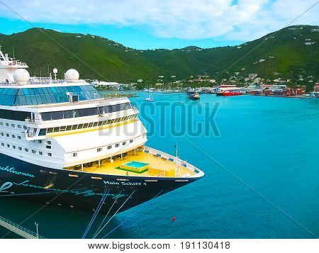 Road Town, Tortola, British Virgin Islands - February 06, 2013: Cruise ship Mein Schiff 1 docked in port Caribbean at Road Town, Tortola, British Virgin Islands on February 06, 2013
