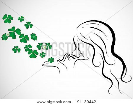 Silhouette of beauty woman blowing to clover leaves