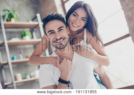 Love Forever. Beautiful Couple Of Young Hispanic Lovers Are Hugging With Tenderness Indoors At Home,