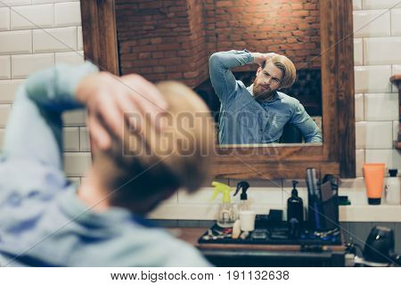 Barbershop Concept. Reflection Of Red Bearded Harsh Stylish Man In The Mirror. He Has A Fashionable