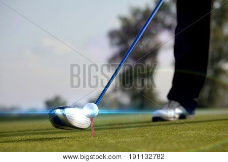 Person playing golf, low section