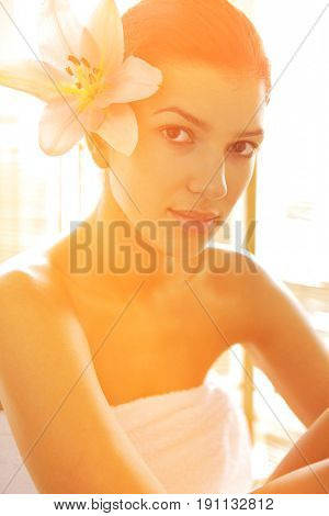 Portrait of young woman wrapped in towel
