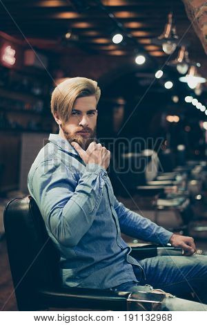Close Up Portrait Of Harsh Stylish Red Bearded Man In A Barber Shop. His Hairstyle Is Spectacular An